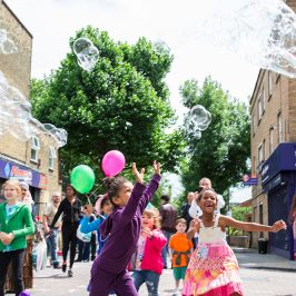 Children chasing giant bubbles at Roman Road Festival 2014