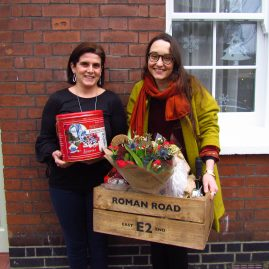 Winner receiving prize of Roman Road E2 Christmas Hamper