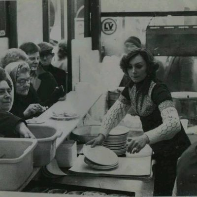 Serving up at G Kelly pie and mash shop, from the Living in Bow image archive project on Facebook