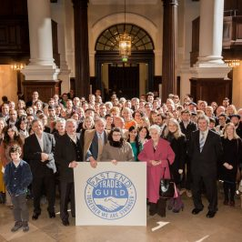 East End Trades Guild group photo with logo