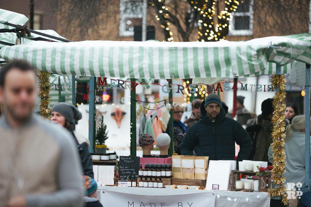 Roman Road Christmas Fair market with fairy lights in the trees