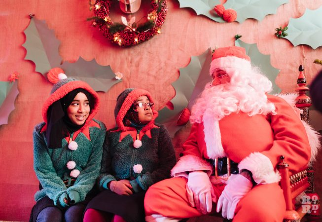 Santa in his Grotto and his two elves at Roman Road Christmas Fair 2016