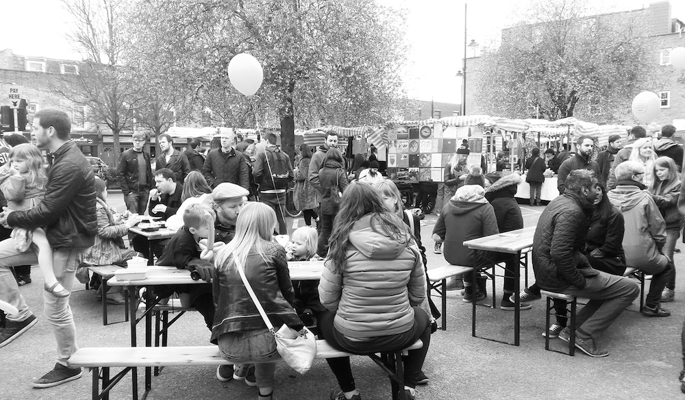 Crowds of shoppers at community market on Roman Road East London