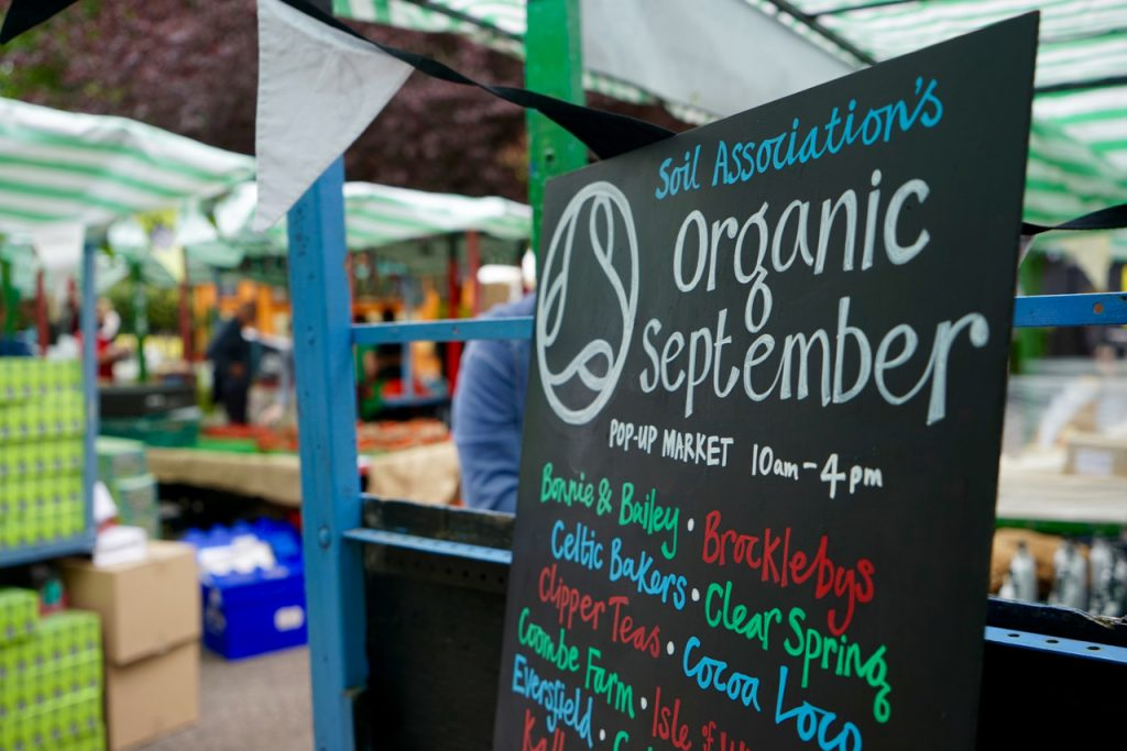 Organic September blackboard at street market