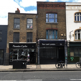 Shopfronts in Globe Town with Paradise Cycles