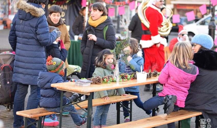 Festive celebrations at Music on the Square in Globe Town, East London.