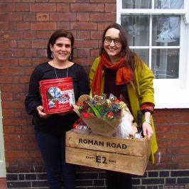 Winner receiving prize of Roman Road E2 Christmas Hamper